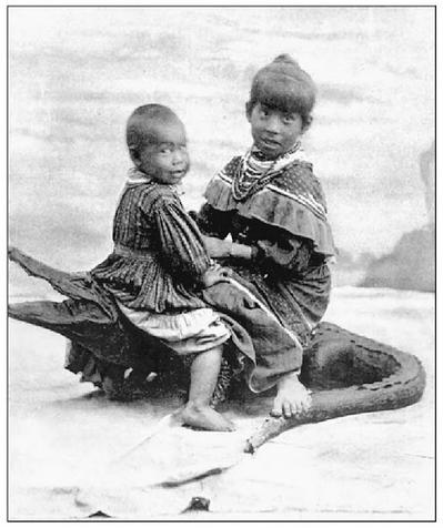 Children with Stuffed Alligator